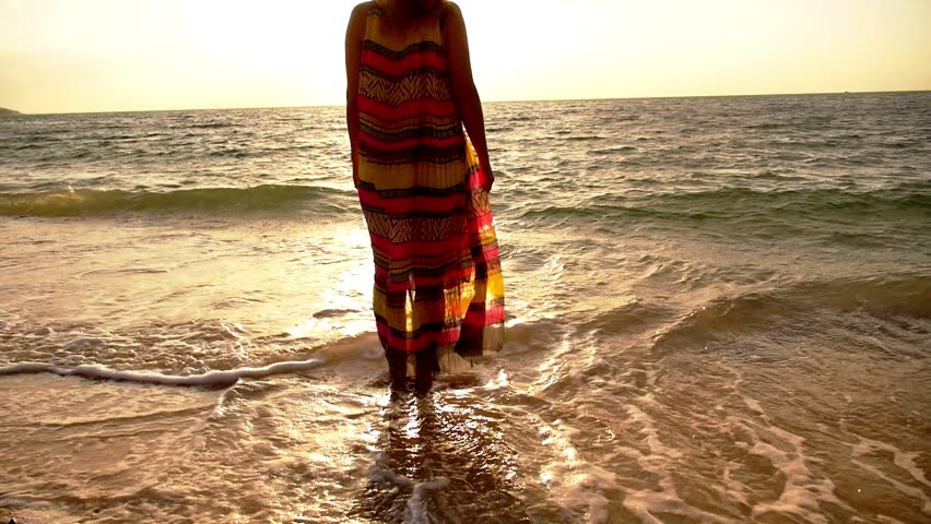 Pretty Woman With Curly Hair In Beautiful Long Dress Standing On Coast Foamy Sea And