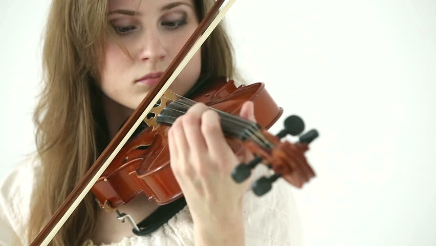 Caucasian violinist girl on a white background. Closeup. | Shutterstock HD Video #6838318