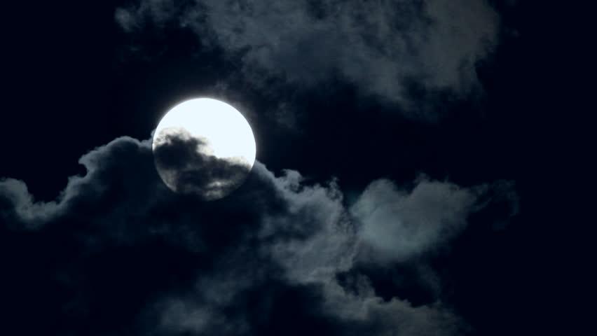 Eerie Full Moon Drifting Amid Dark Clouds. | Shutterstock HD Video #6842317