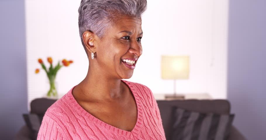 mature black video Mature black grandma webcamming on tablet Stock video.