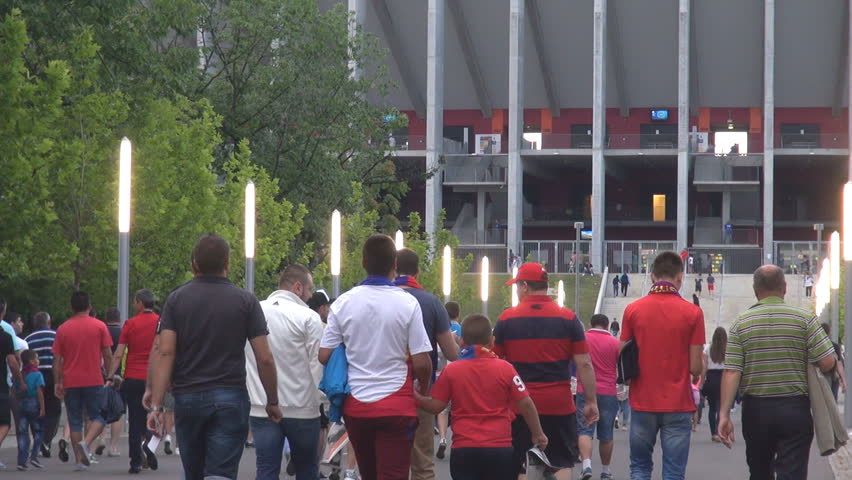 BUCHAREST, ROMANIA - JULY, 15 2014 Football soccer supporters entering in modern arena celebrating, stadium view
