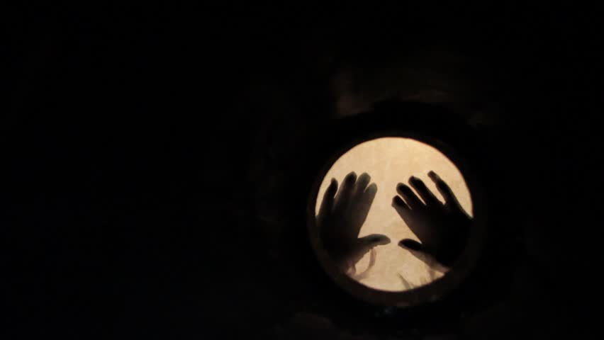 Hands playing drums where everything around drum and hands is dark.  The shot was taken from the opposite side of the drum so it shows us a very different angle    Shutterstock HD Video #6889558