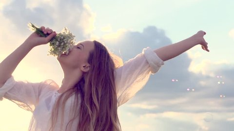 Happy girl with long hair having fun outdoor. Beauty girl spinning, jumping and laughing. Countryside. Nature. Freedom. Slow motion video footage 1080p full HD. High speed camera shot