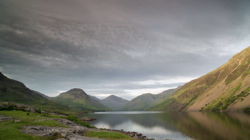 sunset, day to night timelapse of the beautiful lake of wastwater in the lake district national park, england