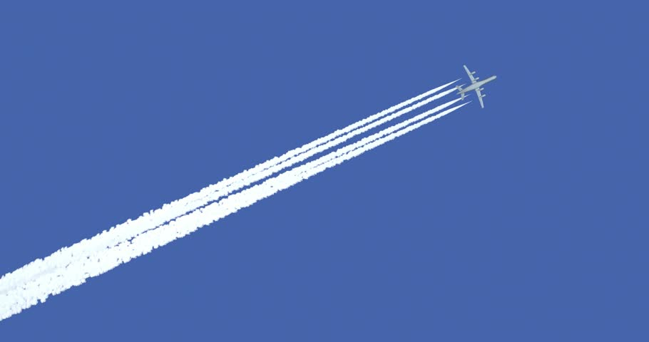 Jet airplane with trail against the blue sky. 4k animation with alpha matte