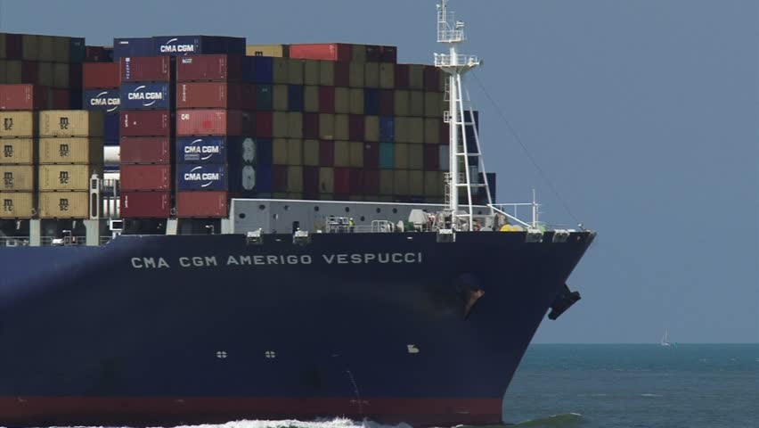 PORT OF ROTTERDAM - JULY 2014: Large container ship CMA CGM Amerigo Vespucci navigates, bound for Rotterdam - close up bow. The Eurogeul allows deep-water sea access to the Port of Rotterdam.