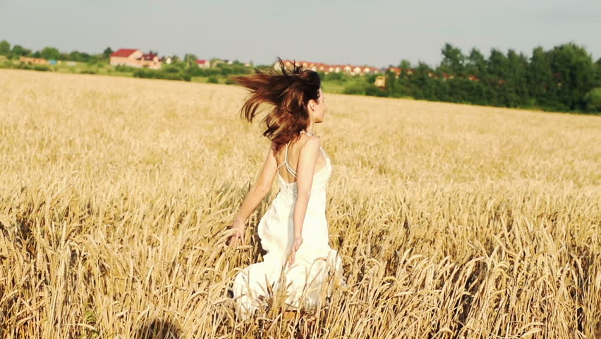 Young woman running on wheat field, super slow motion, 240fps