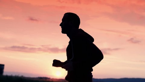 silhouette of man jogging in the country super slow motion, 240Fps