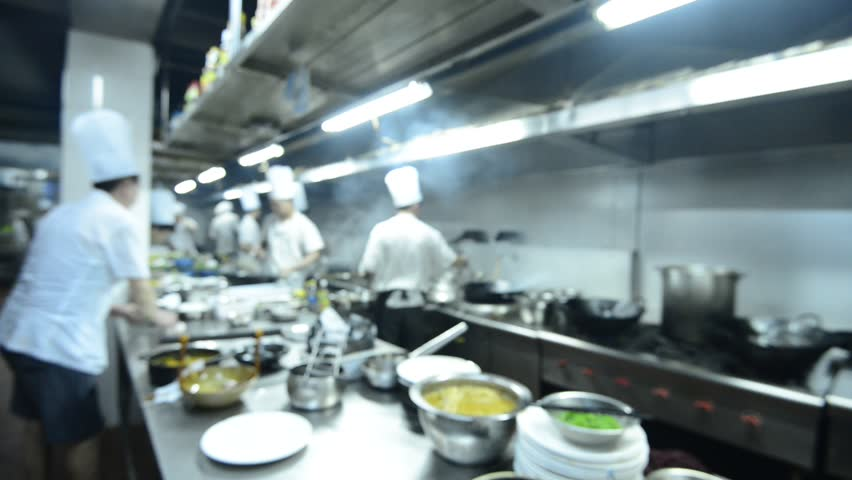 Restaurant Kitchen Video blur background : chefs cooking food in a restaurant kitchen stock