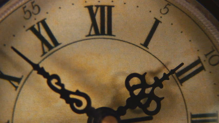 Closeup vintage clock face ticking off seconds in real time