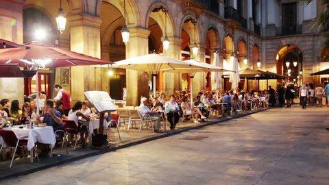 BARCELONA, SPAIN - JULY 18, 2014: Night view of Placa Reial with restaurants in Barcelona