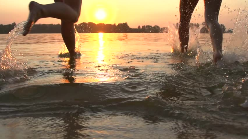 Group Of Happy Teen Girls Playing In Water At The Beach -9305