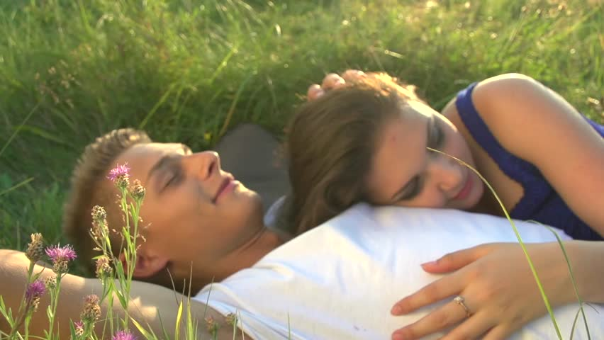 Image result for couple lying in a field