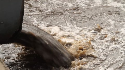 Treatment plants, bubbling water with sewage is discharged from the pipe