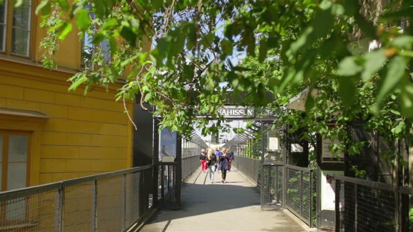 Stockholm, Sweden, June 2013 - People crossing a walk bridge in Stockholm, Sweden | Shutterstock HD Video #7117168