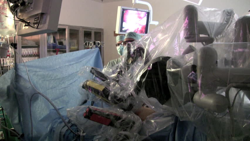 CIRCA 2000s - Robots are used in surgery.