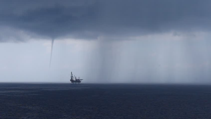 Jack up drilling rig and storm with heavy rain in the middle of the ocean