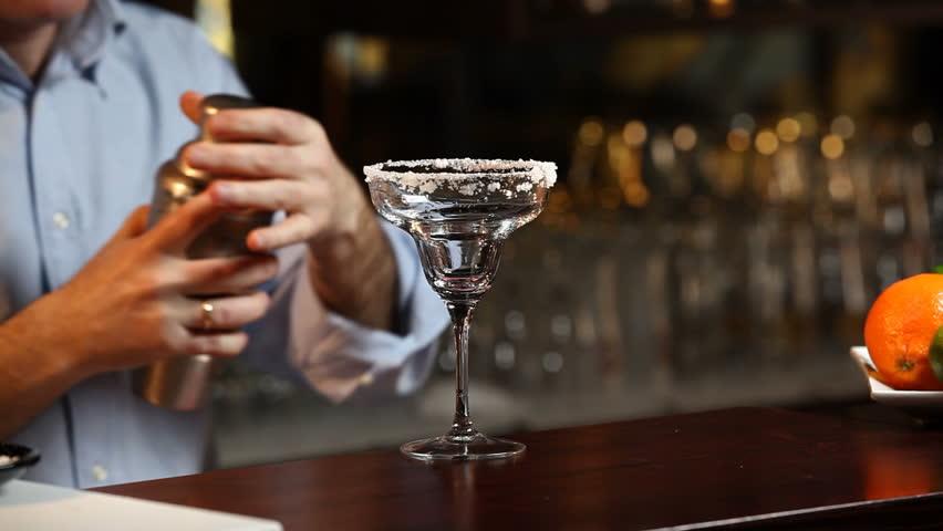 Bartender Serving A Margarita Cocktail