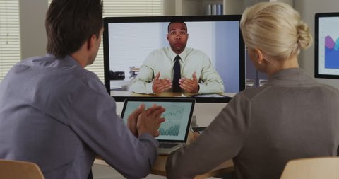 Businessteam listening to manager in a video conference