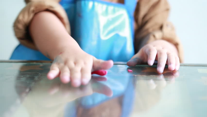 Little girl playing with dough and reflection. | Shutterstock HD Video #7226701