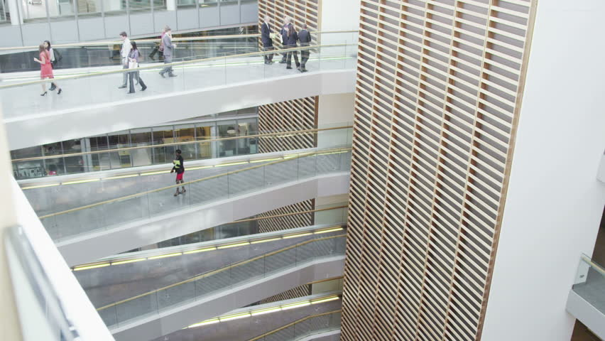 Business people walking along different floors of large modern office building | Shutterstock HD Video #7265158