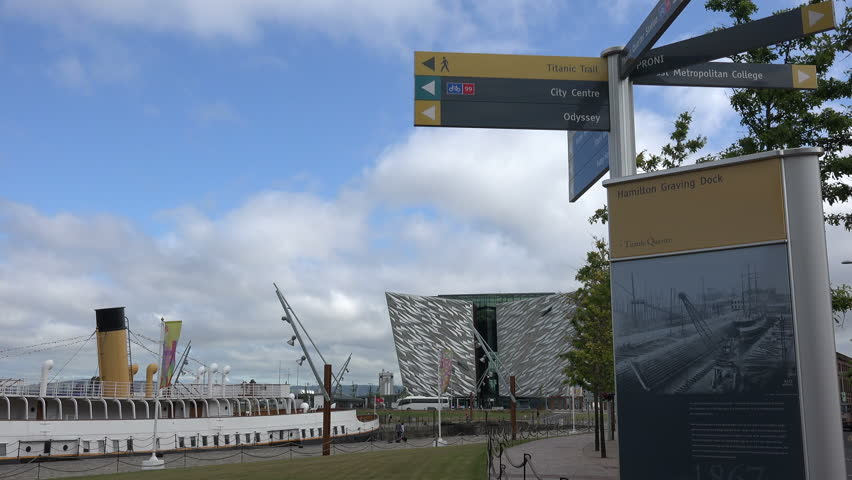 BELFAST, COUNTY ANTRIM/NORTHERN IRELAND - JULY 28, 2014: Tourist signs and direction posts at Titanic Belfast visitor centre. This visitor attraction and monument is to Belfast's maritime heritage. | Shutterstock HD Video #7333468