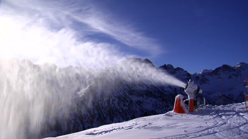 Snowgun making artificial snow in the Alps
