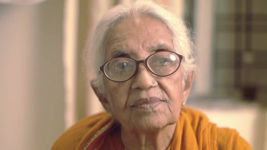 A very old Indian / Asian woman smiling laughing and giggling    Shutterstock HD Video #7363858
