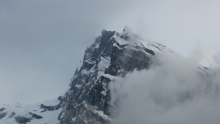 Moving clouds around snow mountain peak. Time lapse - HD stock footage clip