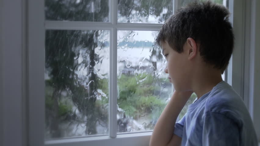 Full HD Child looking through rainy window, multiple angle sequence stock video footage clip