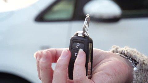 Woman getting new car keys.
