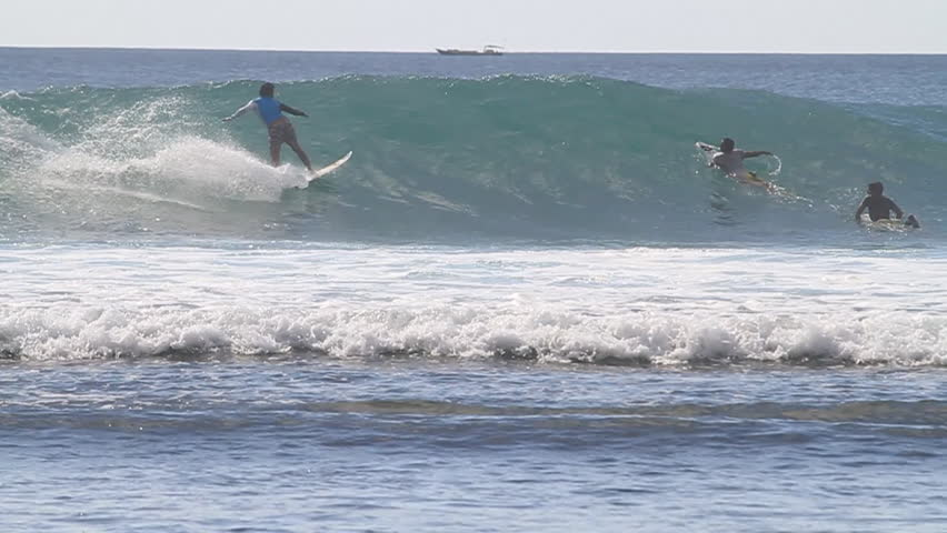 A surfer does a top turn on a nice wave #7442728