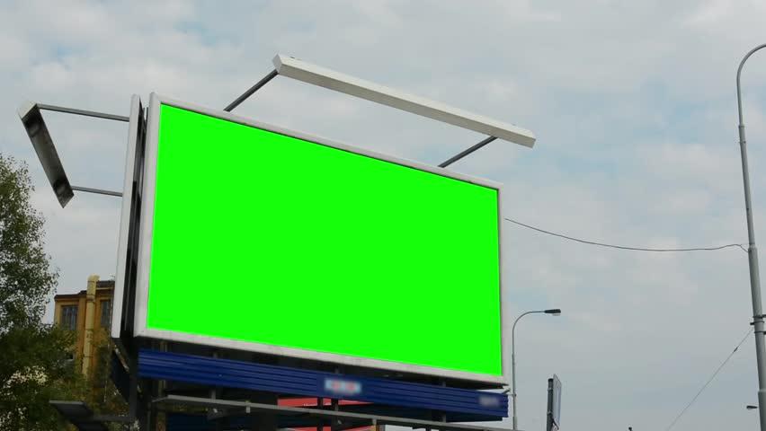 Billboard in the city near road - green screen - buildings in background  | Shutterstock HD Video #7456117