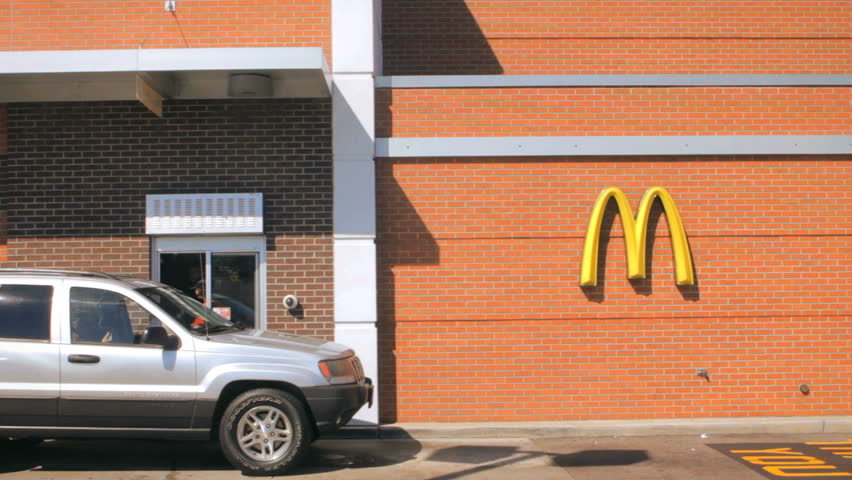 SEEKONK, MA - SEPT 28: (Timelapse) McDonalds restaurant drive thru open for business on September 28, 2014. The McDonald's Corporation is the world's largest chain of hamburger fast food restaurants.