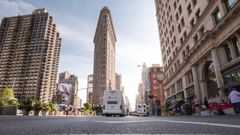 NEW YORK - SEPT 28, 2014: time-lapse of Flatiron Building and clock on 5th Ave in 4K in Manhattan, New York City. Fifth Avenue is a major thoroughfare in Manhattan, NYC, USA.