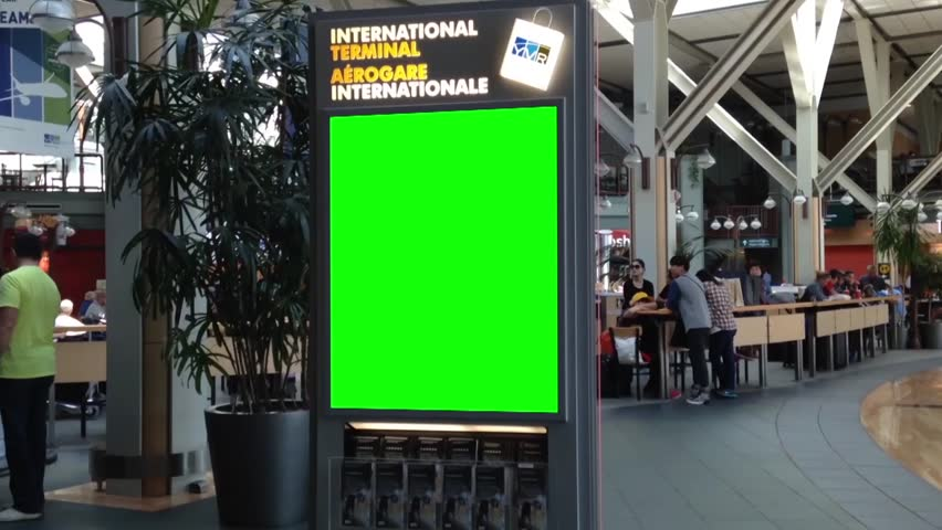 Vancouver, BC Canada - September 13, 2014 : Green direction billboard for your ad inside YVR airport in Vancouver BC Canada.