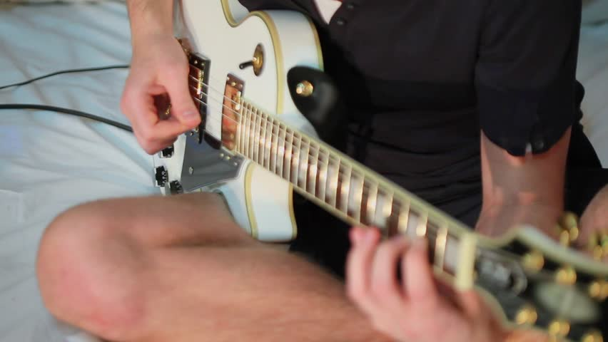 Young Musician Sits At Bed Stock Footage Video 100 Royalty Free