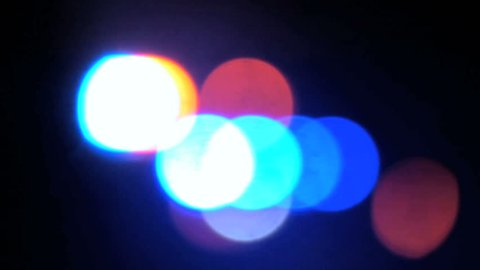 Police car emergency lights at night out of focus