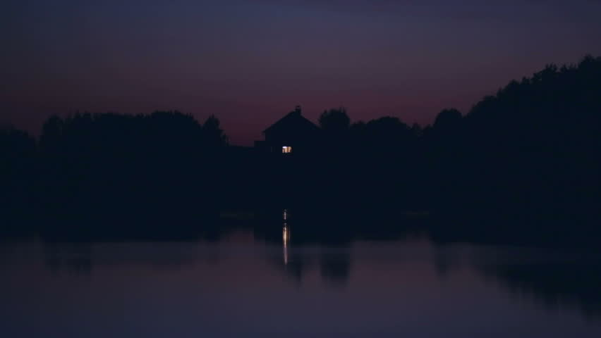 Lonely ascetic house on the lake at night #7497697
