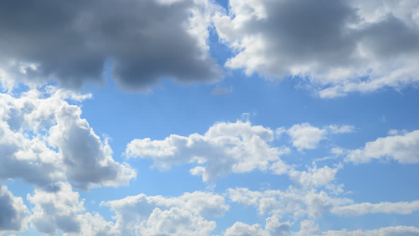 Time-lapse of moving clouds on blue sky