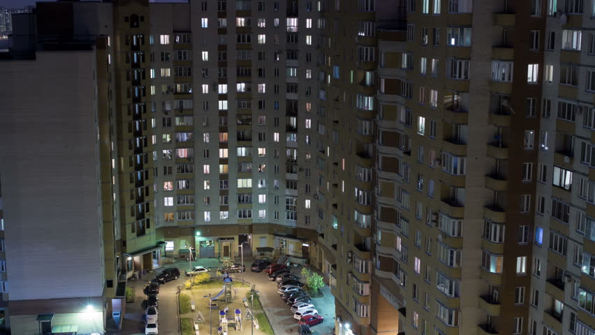 High Rise Apartment Building With Illuminated Windows At Night