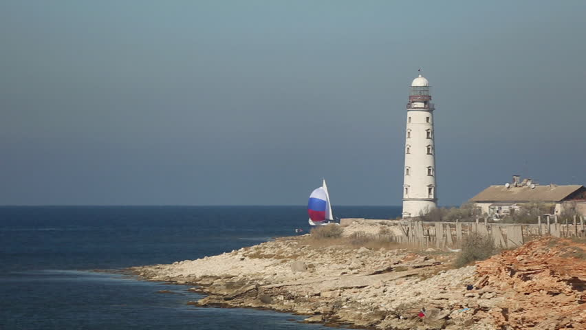 Sailing race on the background of the lighthouse   Shutterstock HD Video #7620808