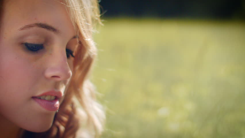 Closeup Of Young Woman Thinking In A Meadow | Shutterstock HD Video #7633558