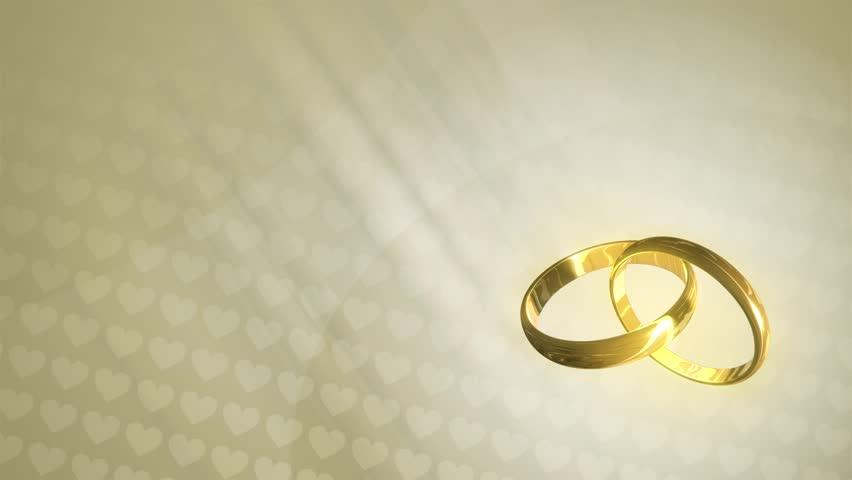 Loopable animated background of three-dimensional wedding rings revolving over a background of hearts. HD 1080p quality 29.97fps.