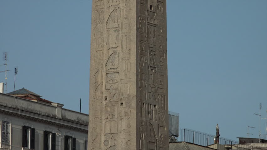 ROME, ITALY - OCT 2014: Hieroglyphics, zoom out - Lateran Obelisk, tallest in Rome, near Archbasilica of St. John Lateran. Largest Egyptian obelisk in world, Piazza di San Giovanni in Laterano.   Shutterstock HD Video #7736848