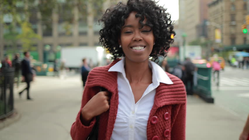 Young African American black woman in New York City walking smiling face | Shutterstock HD Video #7740598