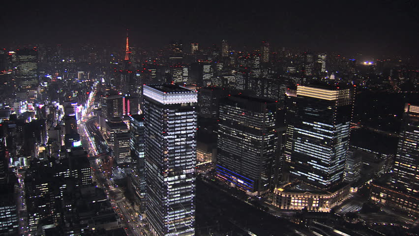 Aerial Metropolis night illuminated entertainment area offices skyscrapers Tokyo Tower city blocks structure Business District Japan