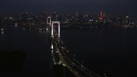 Aerial illuminated Metropolis city skyscrapers night Tokyo Bay Rainbow Bridge transport travel Odaiba Japan Asia
