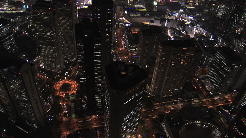 Aerial Metropolis Tokyo night illuminated city offices skyscrapers city blocks traffic structure growth transport Business District Japan Asia   Shutterstock HD Video #7792918
