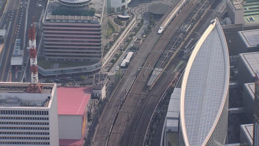 Aerial overhead view TGV Bullet train downtown Tokyo city motion travel growth National Rail Japan Asia